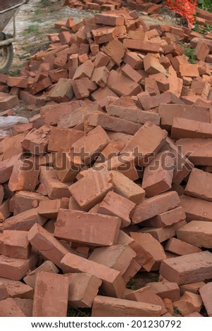 Pile of red bricks at a construction site. Selective focus. - stock photo