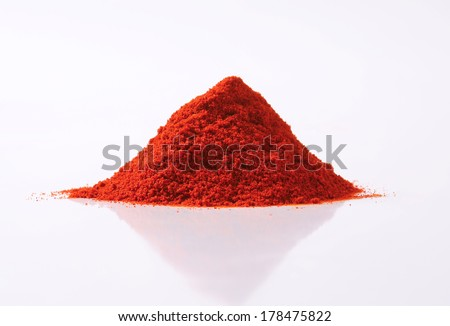 pile of red pepper powder - stock photo