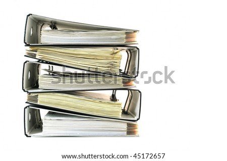 Pile of ring binders with documents