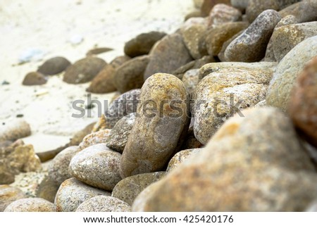 Pile of rocks on coastline for relaxation in nature background - stock photo