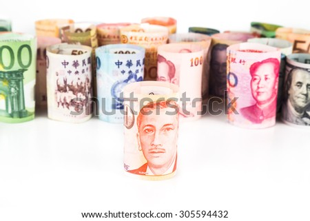 Pile of rolled-up currency notes with Singapore Dollar in front. - stock photo