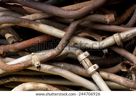 Pile of rusty old exhaust pipes - stock photo