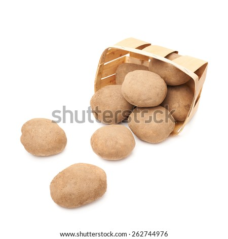 Pile of scattered out of the basket potatoes isolated over the white background - stock photo