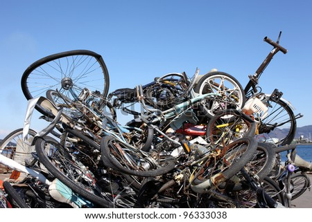 Pile of scrap metal against blue sky - stock photo