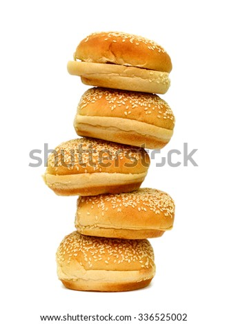 pile of sesame buns on white background