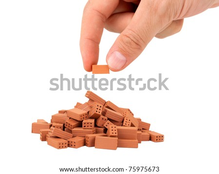 Pile of small bricks on white background