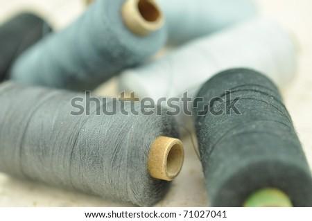 Pile of spools closeup - stock photo