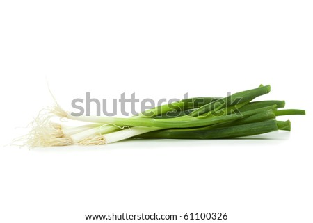 pile of spring onions isolated on white background - stock photo