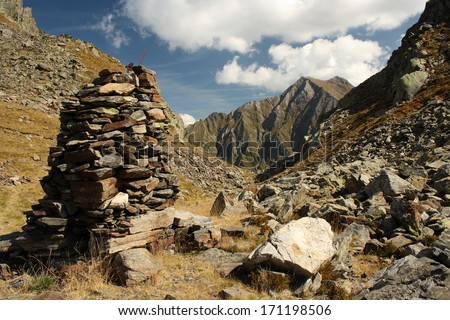 pile of stones marking way in Pyrenees, Spain - stock photo