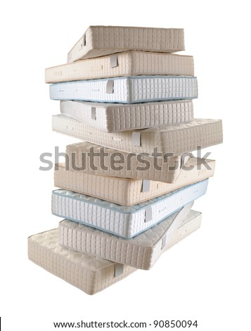 pile of ten mattresses isolated on white - stock photo