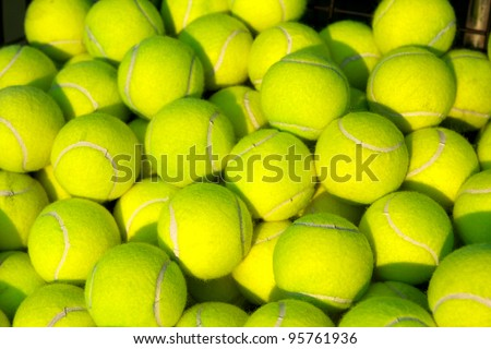 Pile of Tennis Balls from a hopper - stock photo