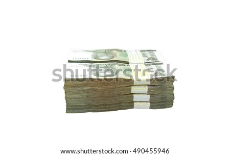Pile of Thai money with glasses and notebook on wood table financial concept