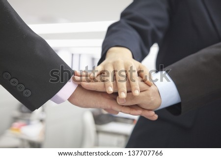 Pile of Three Business People Hands Together - stock photo