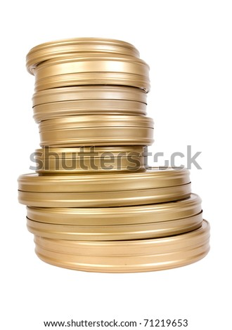 Pile of tins with a film on a white background - stock photo