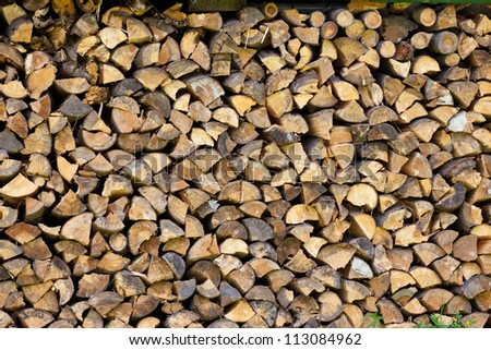 Pile of  tree logs prepare for fire - stock photo