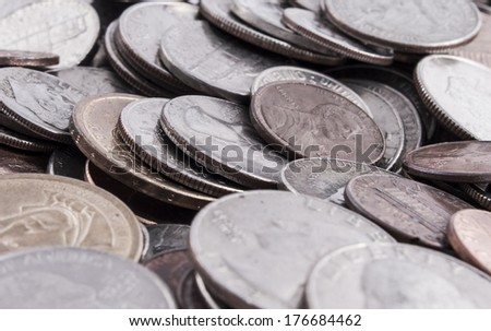 Pile of U.S. coin, nickels.dimes,quarters,pennies, and dollar coins - stock photo