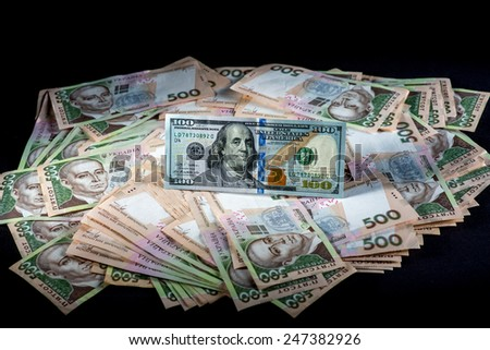 Pile of Ukrainian and American money banknots - stock photo