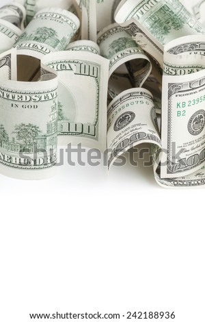 Pile of United States dollar hundred USD banknotes on white table with empty place on a foreground. Selective focus