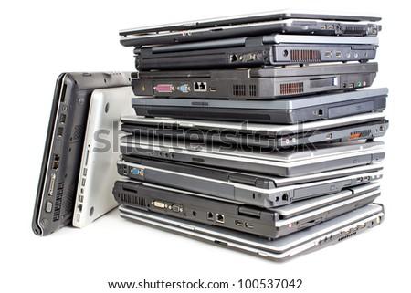 Pile of used laptops, white background - stock photo