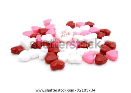 "Pile of Valentines Day heart-shaped candies with ""Be Mine"" conversation heart - stock photo"