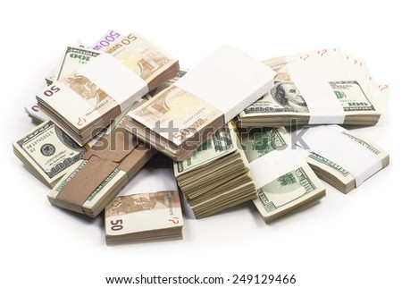 Pile of various currencies isolated on white background - stock photo