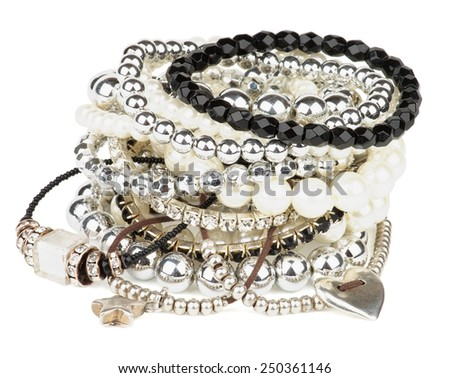 Pile of Various Pearl, Silver and Black Jewelry Gems Bracelets isolated on white background - stock photo