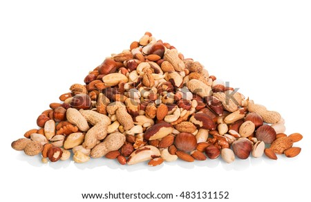 Pile of various whole and peeled nuts isolated on white background.
