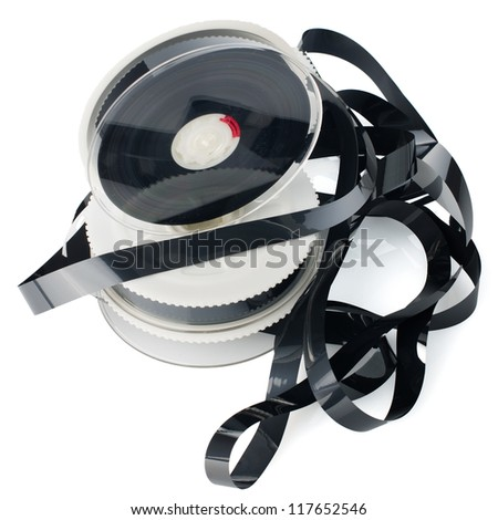 Pile of videotape reels on  white reflective background. - stock photo