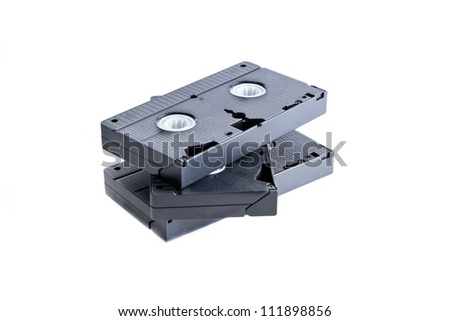 Pile of videotapes on  white background. - stock photo