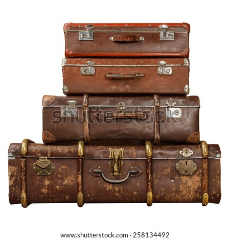 Pile of vintage suitcases isolated on white background. Vintage travel luggage