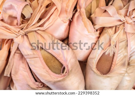 Pile of vintage worn ballet shoes - stock photo