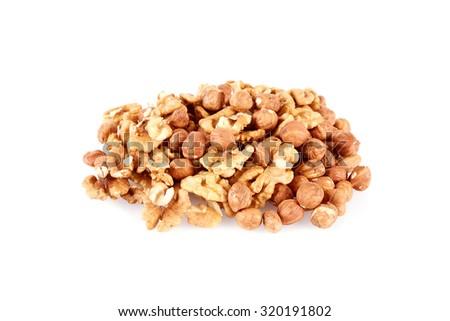 Pile of walnut kernels and peeled hazelnuts isolated on white - stock photo