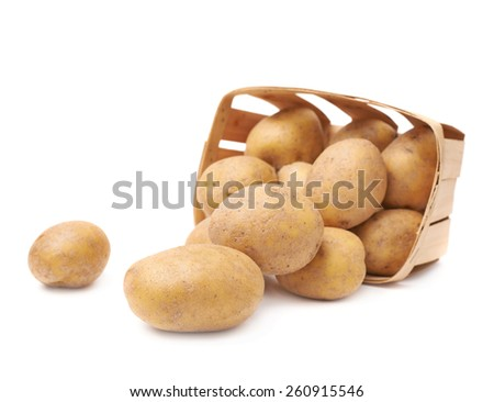 Pile of washed brown potatoes in a wooden basket, composition isolated over the white background - stock photo