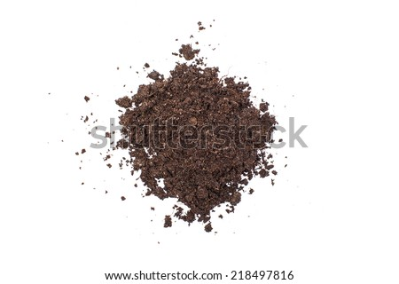 Pile of wet soil isolated on white background - stock photo