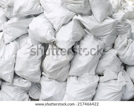 Pile of white sacks - stock photo