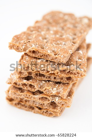 Pile of Whole Grain Healthy Crackers Isolated on White Background - stock photo
