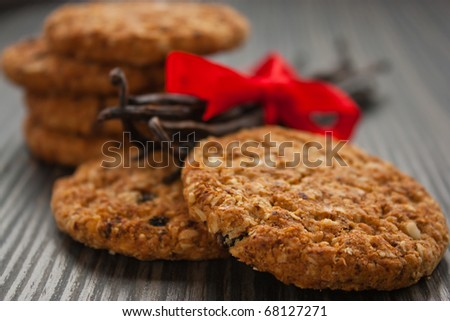 Pile of wholegrain cookies with raisins and nuts.