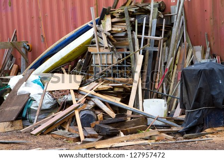 pile of wood ready to burn or dump at landfill - stock photo