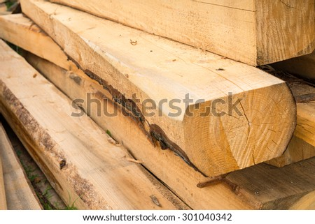Pile of wooden beams in the construction site. Close up. - stock photo