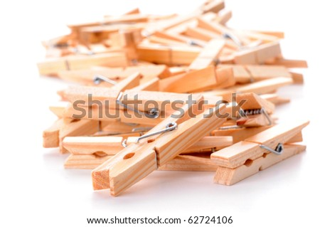 Pile of wooden clothespins on a white background.