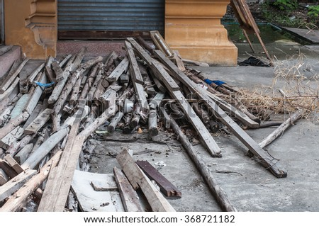 Pile of Wooden planks of a demolished house - stock photo