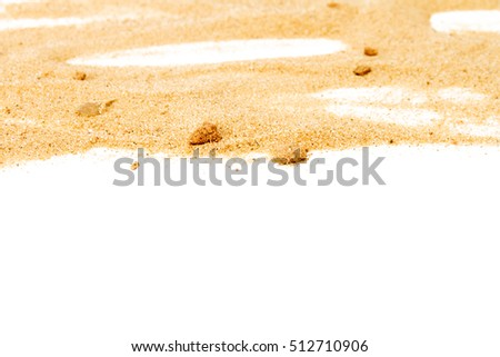 Pile of yellow sand isolated on white background, selective focus at front