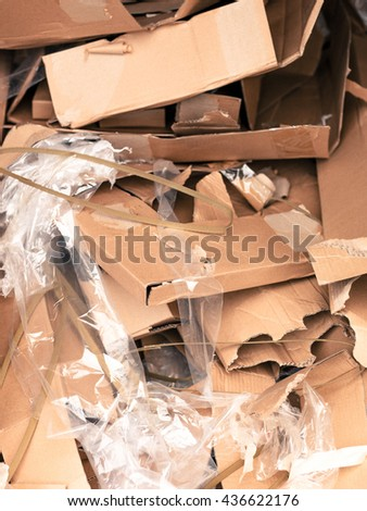 Pile or Stack of Empty Cardboard Boxed and Plastic Wrapping Material Dumped in a Heap of Waste - stock photo