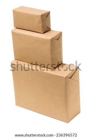 Pile parcel wrapped with brown kraft paper