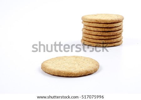 Pile stack of diet whole grains crackers isolated over the white background. Healthy living concept for food.