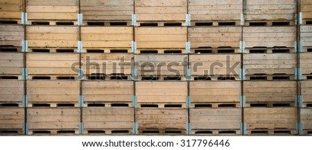 piled up empty crates for the apple and pear harvest in the betuwe, netherlands - stock photo