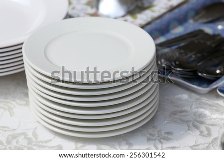 Piled with dishes - stock photo