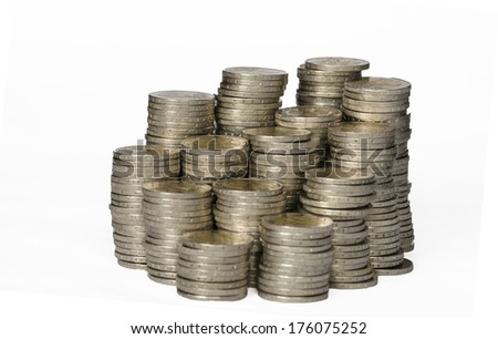 piles of coins on white background - stock photo