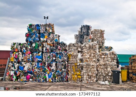 Piles of colorful plastic waste on a recycling site - stock photo