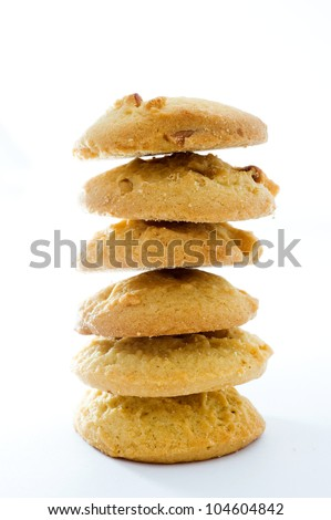piles of cookies on white background